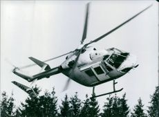 Flying helicopter in air.