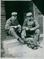 Two soldiers knitting socks during world war I in 1914The idyll in tattersfunny picture from the war seriously yes German soldiers themselves to stop their socks Sept-October. 1914