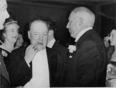 Winston Churchill touching his teeth.