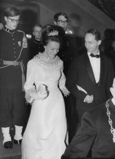 Princess Irene of the Netherlands with husband Duke Carlos Hugo walking down the stairs.