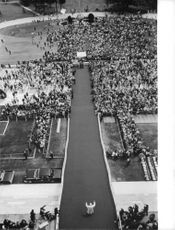 People gathered for a ceremony, Pope Paul VI walking.