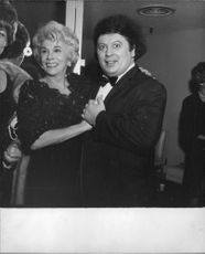 Marty Allen standing with a woman.
