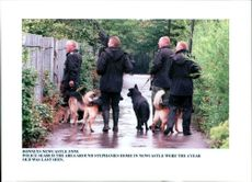 Stephanie gribben: police with dogs searching.