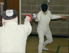 Cathie demonstrates the art of epee fencing.