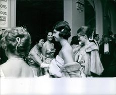 Princess Birgitta looking at something and smiling during an event.
