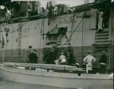 Sailors in ship and boat.