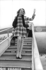 Carroll Baker waving.