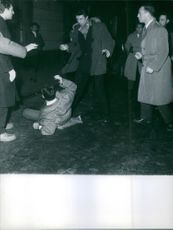 People beating a man.