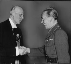 Prince Carl shakes hands with Count Folke Bernadotte, the Red Cross annual general meeting. - 2 June 1944