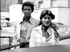 American tennis player Arthur Ashe with girlfriend Lois Wise in London during Wimbledon 1976