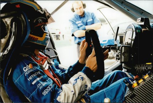 The wheel is put in place as one of the last moments before Rickard Rydell gets out on the track at Brands Hatch.
