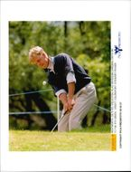 Golf player Klas Eriksson chases 9th green under Volvo PGA 1995