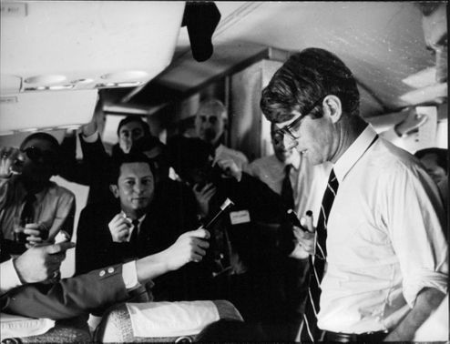 """Press reporters asking Robert Francis """"Bobby"""" Kennedy."""