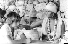Claudia Cardinale wiping her son`s face.