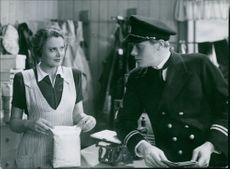 "Birgit Tengroth with Erik Faustman on set in the 1943  Swedish drama film, ""Katrina""."