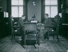 Two officers working in office.1919