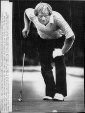 Golf player Jack Nicklaus is preparing a putt during the Doral Open 1980