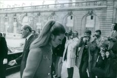 Princess Zahra is walking with head looking down at steps while being photographed by press.    Princess Zahra Aga Khan (born 18 September 1970 in Geneva, Switzerland) is the eldest child of Aga Khan IV.