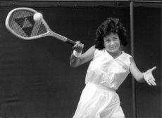 Rina Einy playing tennis.