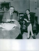 René Pleven sitting and having tea with his wife.
