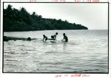 Children playing in the sea.