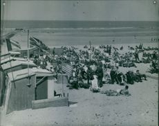 People relaxing and sun bathing in the beach of Blankenberg.
