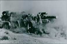 Military vehicle spreading dust on battlefield during South Africa War. 1941.