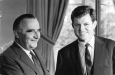 """Edward Moore """"Ted"""" Kennedy with a man, smiling."""