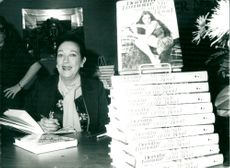 """Dorothy Lamour signs his book """"My Side of The Road"""""""