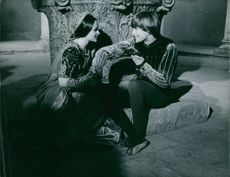 """A scene from the film """"Romeo and Juliet"""" showing the young lovers of Verona, Leonard Whiting and Olivia Hussey, exchange their first passionate kiss, 1967."""