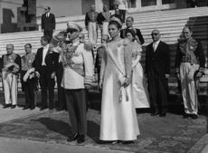 A man and a woman paying tribute during a ceremony.