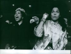 Sugar Ray Robinson's own cheering squad was his Wife and Sister during his fight.