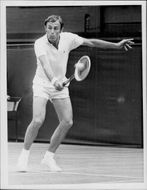 John Newcombe plays against Tom Okker in the Wimbledon Championship