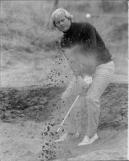Golf player Jack Nicklaus gets out of the bunk during the British Open 1975