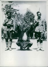 A photo shot posing of three soldiers.