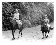 Princess Josephine Charlotte and Prince Baudouin ride together at Schloss Laken - 1 June 1938