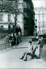 Woman relaxing on bench.
