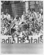 Chris Nicholl and Gordon Smith are fighting for the ball