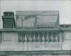 Photo of a terrace which has a big gun set-up.  Taken - Mar. 1962