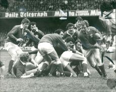 Geoff Wheel and the welsh prop Froward as he makes a break from a scrum.