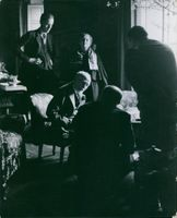 Bernard Berenson sitting with other people and having discussion with them.