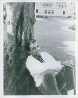 Johnny Mathis photographed sitting by the tree.
