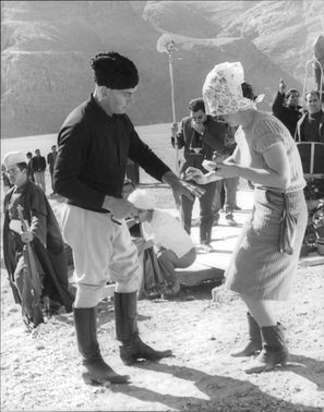 Injured Yul Brynner being treated.