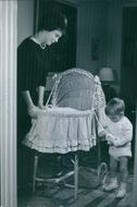 Helle Genie Virkner standing and playing with her baby.