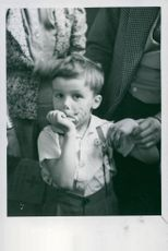 A little boy getting his first chocolate after the war in Germany.
