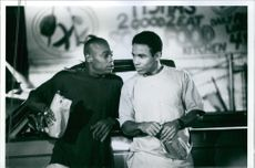 """1994  Allen Payne and Bokeem Woodbine talking to each other during a movie scene """"Jayson's Lyric""""."""