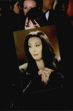 Angelica Huston held a picture of Morticia Addams
