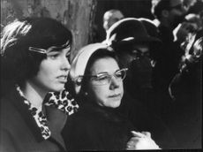 People grieving at John F. Kennedy's funeral.