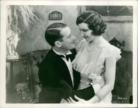 Maurice Chevalier facing his wife and doing romance.