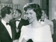 Betsy Blair in a party and smiling.